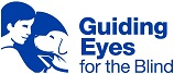 Logo of Guiding Eyes for the Blind, a woman holding a guide dog in her arms